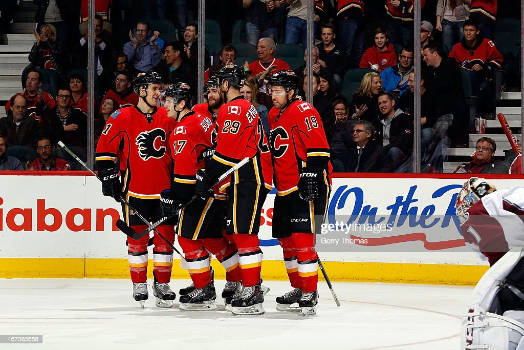 Lance Bouma #17, Deryk Engelland #29 and teammates of the Calgary Flames celebrate a goal against the Colorado Avalanche at Scotiabank Saddledome on March 23, 2015 in Calgary, Alberta, Canada.