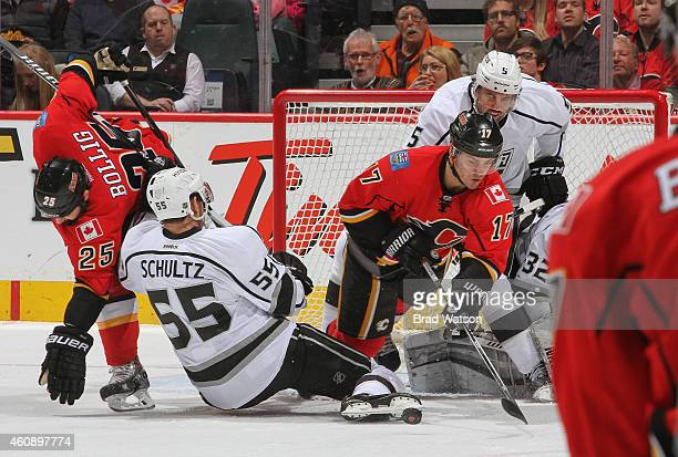 Lance Bouma of the Calgary Flames battles for the puck against Jeff Schultz of the Los Angeles Kings at Scotiabank Saddledome on December 29 2014 in...