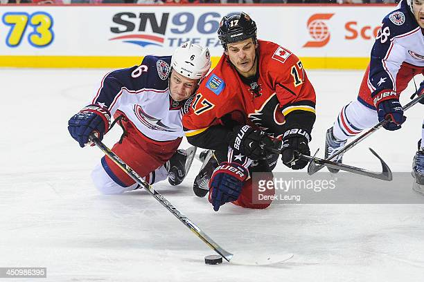 Lance Bouma of the Calgary Flames fights for the puck against Nikita Nikitin of the Columbus Blue Jackets during an NHL game at Scotiabank Saddledome...