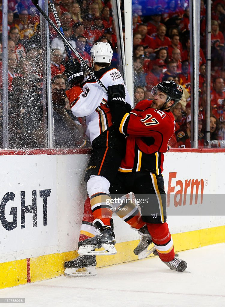 Lance Bouma #17 of the Calgary Flames hits Clayton Stoner #3 of the Anaheim Ducks against the boards in Game Four of the Western Conference Semifinals during the 2015 Stanley Cup Playoffs at the Scotiabank Saddledome on May 8, 2015 in Calgary, Alberta, Canada.