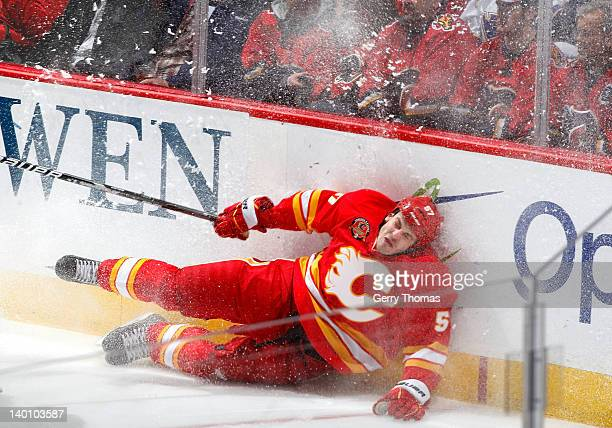 Lance Bouma of the Calgary Flames lands hard against the boards during the game against the St. Louis Blues on February 27, 2012 at the Scotiabank...
