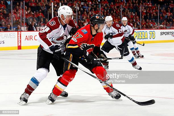 Lance Bouma of the Calgary Flames skates against Patrick Wiercioch of the Colorado Avalanche during an NHL game on January 4 2017 at the Scotiabank...