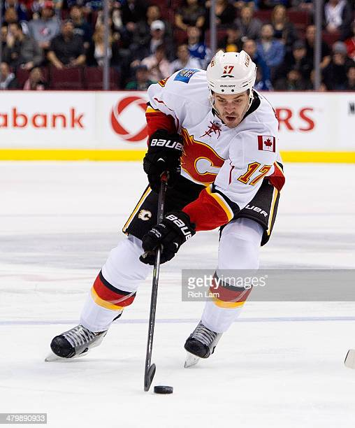 Lance Bouma of the Calgary Flames skates with the puck during NHL action against the Vancouver Canucks on March 08 2014 at Rogers Arena in Vancouver...