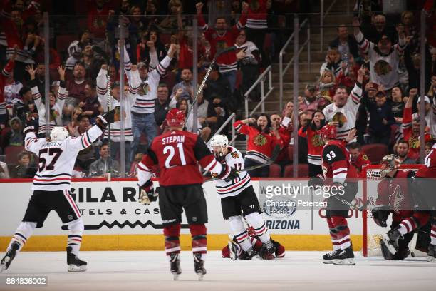 Lance Bouma of the Chicago Blackhawks celebrates with Tommy Wingels after scoring a goal against goaltender Louis Domingue of the Arizona Coyotes...