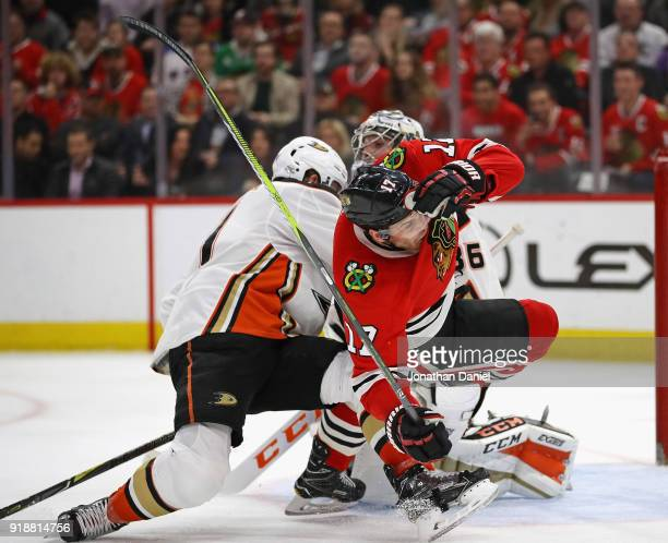 Lance Bouma of the Chicago Blackhawks hits the ice after colliding with Cam Fowler of the Anaheim Ducks in front of John Gibson at the United Center...