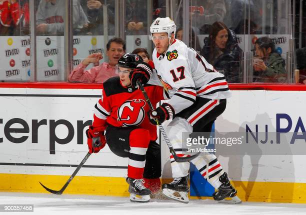 Lance Bouma of the Chicago Blackhawks in action against Nico Hischier of the New Jersey Devils on December 23 2017 at Prudential Center in Newark New...