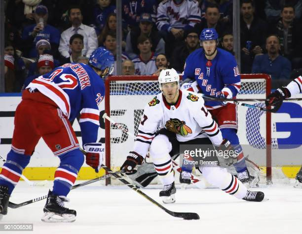 Lance Bouma of the Chicago Blackhawks looks to block a shot by Kevin Shattenkirk of the New York Rangers during the second period at Madison Square...