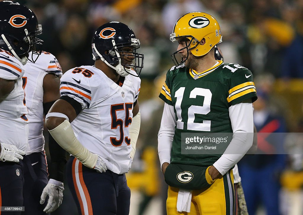 Lance Briggs #55 of the Chicago Bears talks with quarterback Aaron Rodgers #12 of the Green Bay Packers in the first half of the game at Lambeau Field on November 9, 2014 in Green Bay, Wisconsin. Green Bay Packers defeat the Chicago Bears 55 to 14.