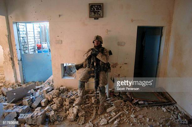 Lance Corp Jason Canellis sits in a destroyed room as US Marines of the 1st Light Armored Reconnaissance company as part of 1st Battalion 3rd Marines...