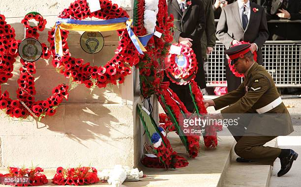 Lance Corporal Johnson Beharry holder of a Victoria Cross lays a wreath on behalf of First World War veteran Harry Patch aged 110 during a...