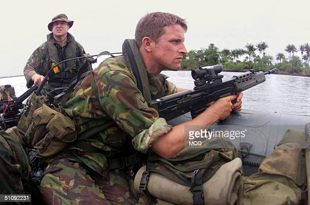 Lance Corporal Lee Graham From Hereford Serving With 1St Battalion The Parachute Regiment Scans The Coastline As He And His Section Approaches...