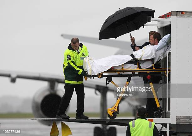 Lance Corporal Matthew Ball is wheeled to an ambulance at Whenuapai Air Force Base on August 7 2010 in Auckland New Zealand Lieutenant Tim O'Donnell...