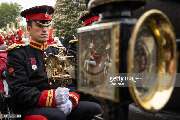 """Lance Corporal of Horse Carl Greenhow wears the Waterloo Medal as he holds the Victorian-era replica of the """"Waterloo Eagle' as it is symbolically..."""