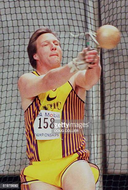 Lance Deal takes his turn during the finals of the 35 pound weight throw at the Mobile Indoor Track and Field Championships 02 March at the Georgia...