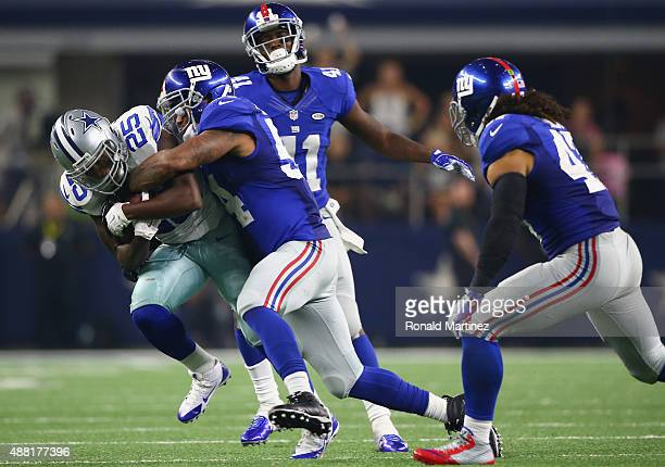 Lance Dunbar of the Dallas Cowboys runs the ball against Jasper Brinkley of the New York Giants at ATT Stadium on September 13 2015 in Arlington Texas