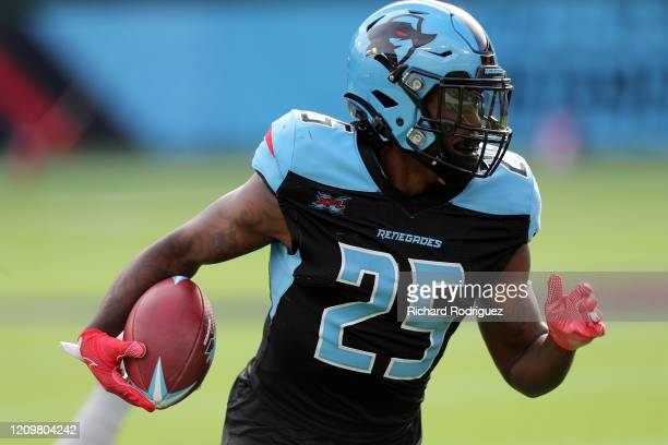 Lance Dunbar of the Dallas Renegades carries the ball against the Houston Roughnecks at an XFL football game on March 01, 2020 in Arlington, Texas.