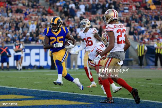 Lance Dunbar of the Los Angeles Rams runs in a touchdown past Ahkello Witherspoon Adrian Colbert and Dontae Johnson of the San Francisco 49ers during...