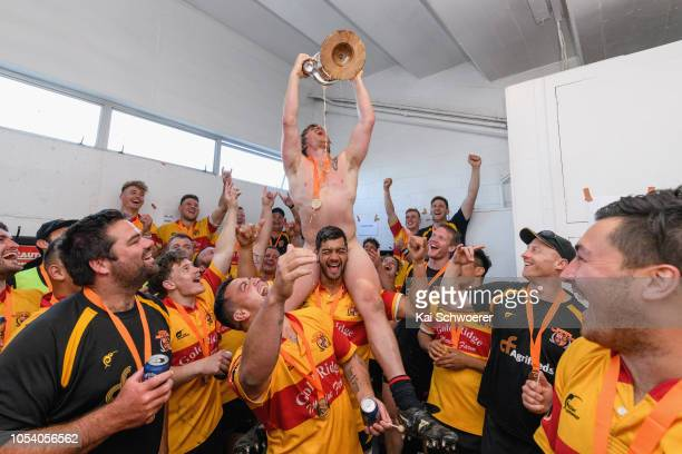 Lance Easton of Thames Valley lifts the Meads Cup after their win in the Heartland Championship Meads Cup Final match between South Canterbury and...