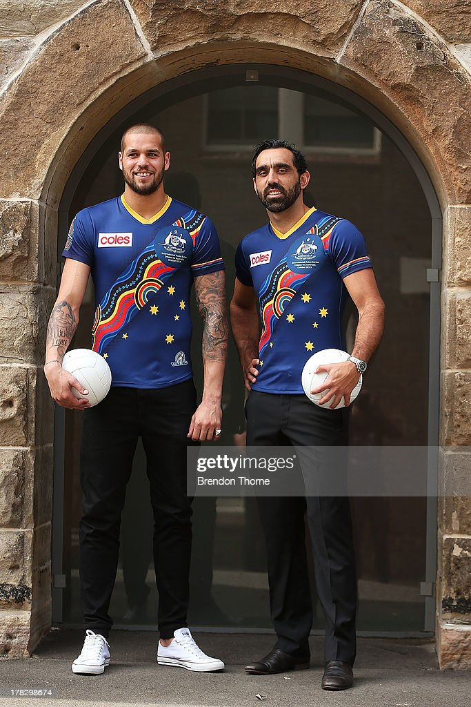 Lance Franklin and Adam Goodes pose in the Indigenous Australian Rules team guernsey following the AFL Indigenous Australian Rules Squad announcement at the National Centre for Indigenous Excellence on August 29, 2013 in Sydney, Australia.
