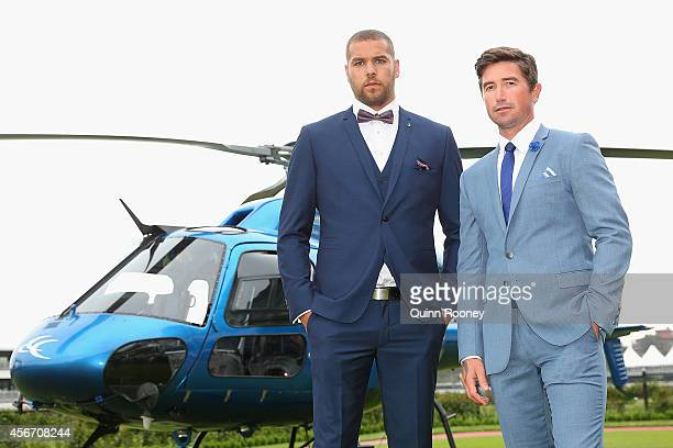 Lance Franklin and Harry Kewell pose for the Politix Spring Racing Campaign at Flemington Racecourse on October 6 2014 in Melbourne Australia