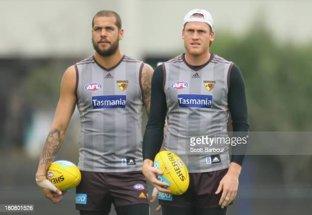 Lance Franklin and Jarryd Roughead prepare to kick the ball during a Hawthorn Hawks AFL training session at Waverley Park on September 17, 2013 in...