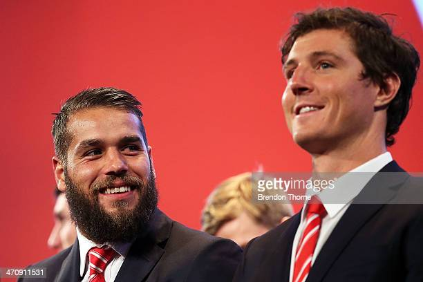 Lance Franklin and Kurt Tippett of the Swans share a joke on stage after receiving their 2014 Sydney Swans guernseys during the Sydney Swans AFL...