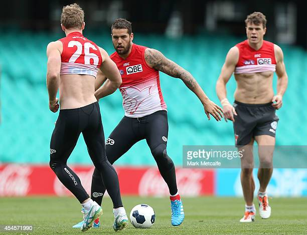 Lance Franklin dribbles with a football during a Sydney Swans AFL training session at Sydney Cricket Ground on September 4 2014 in Sydney Australia