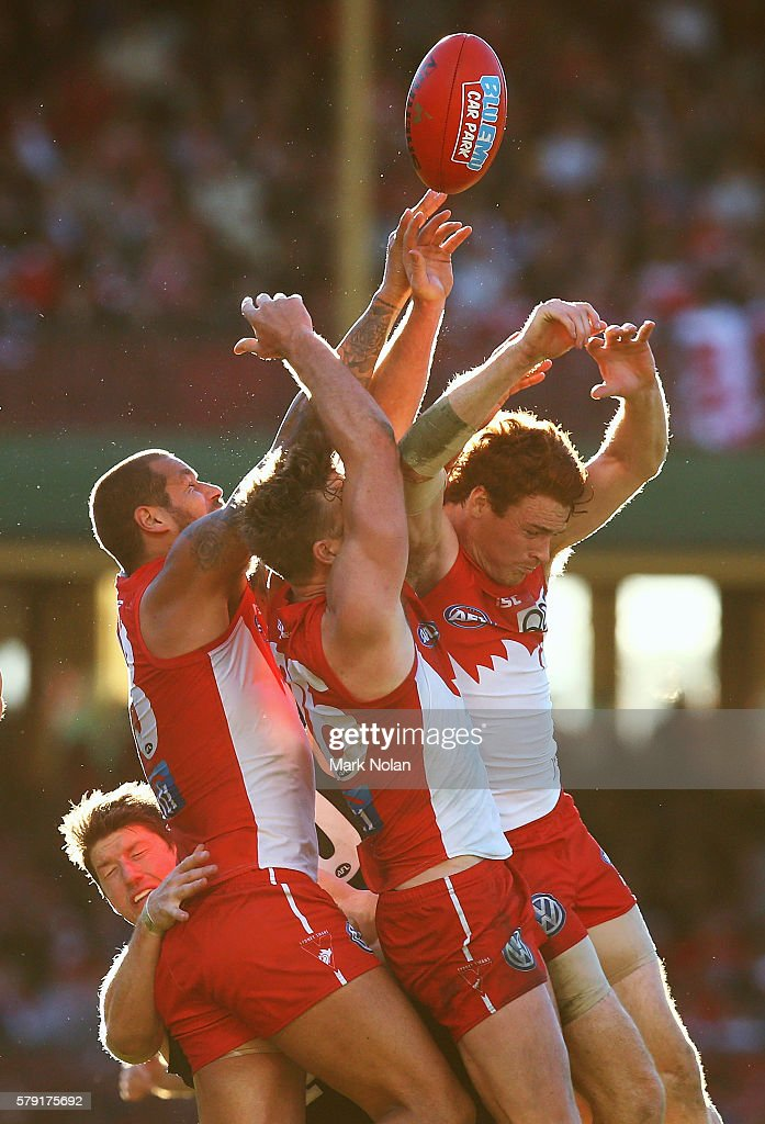 Lance Franklin, Luke Parker and Gary Johan of the Swans contest a mark during the round 18 AFL match between the Sydney Swans and the Carlton Blues at Sydney Cricket Ground on July 23, 2016 in Sydney, Australia.