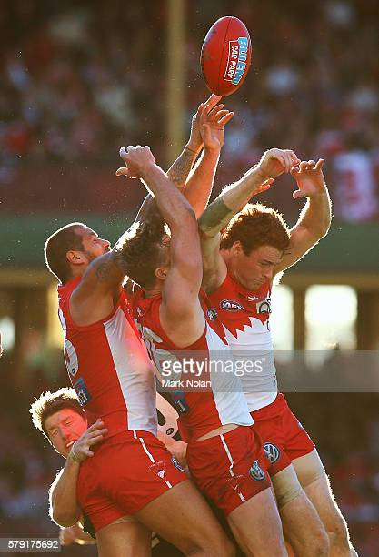 Lance Franklin, Luke Parker and Gary Johan of the Swans contest a mark during the round 18 AFL match between the Sydney Swans and the Carlton Blues...