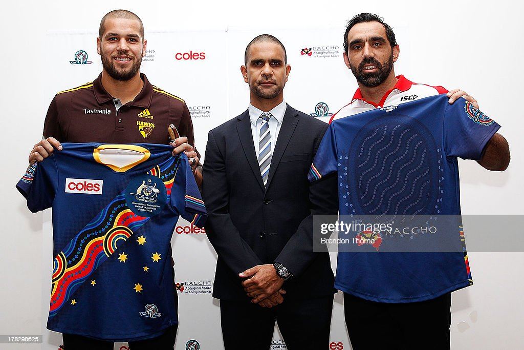 Lance Franklin, Michael O'Loughlin and Adam Goodes pose in the Indigenous Australian Rules team guernsey following the AFL Indigenous Australian Rules Squad announcement at the National Centre for Indigenous Excellence on August 29, 2013 in Sydney, Australia.