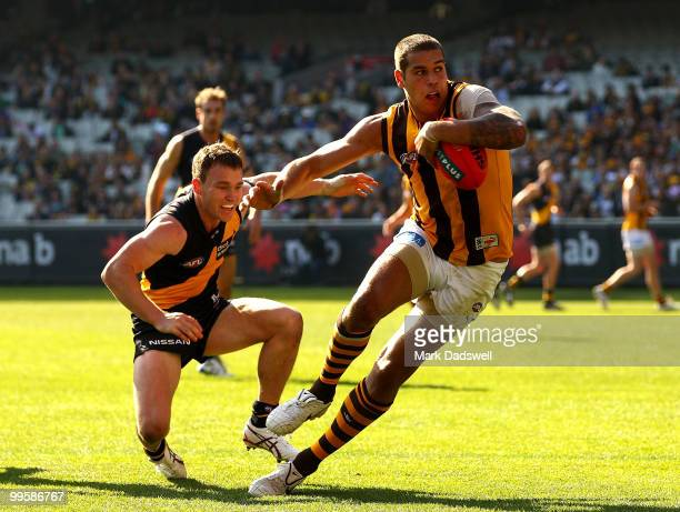 Lance Franklin of the Hawks brushes off the tackle from Nathan Foley of the Tigers during the round eight AFL match between the Richmond Tigers and...