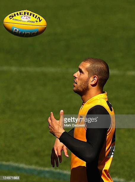 Lance Franklin of the Hawks gathers the ball during a Hawthorn Hawks AFL training session at Melbourne Cricket Ground on September 15 2011 in...