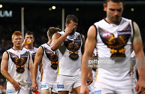 Lance Franklin of the Hawks heads from the field with team mates after being defeated during the round four AFL match between the West Coast Eagles...