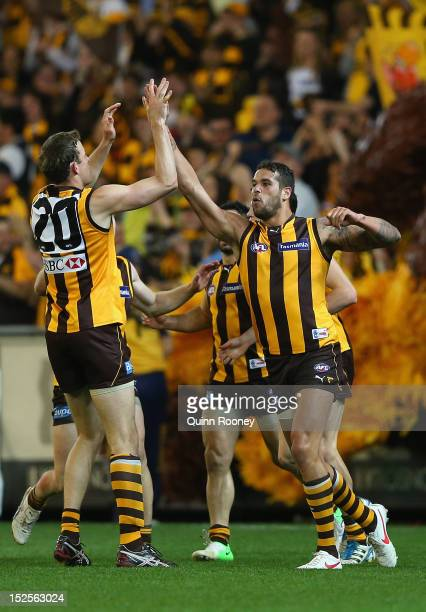 Lance Franklin of the Hawks is congratulated by David Hale after scoring a goal during the second AFL Preliminary Final match between the Hawthorn...