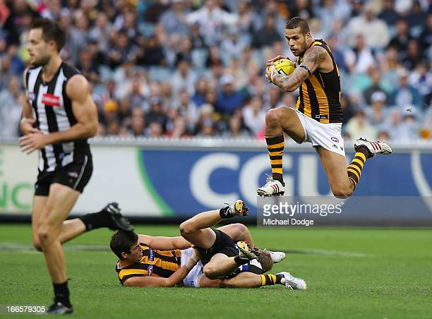 Lance Franklin of the Hawks jumps over players with the ball during the round three AFL match between the Collingwood Magpies and the Hawthorn Hawks...