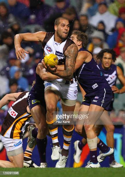 Lance Franklin of the Hawks looks to handball during the round 19 AFL match between the Fremantle Dockers and the Hawthorn Hawks at Patersons Stadium...
