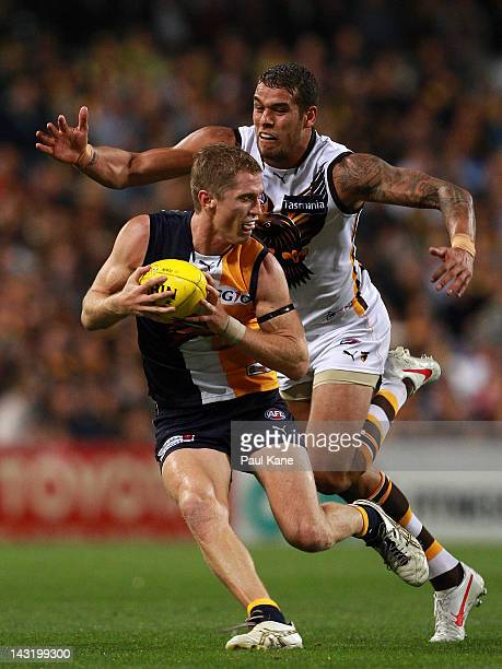 Lance Franklin of the Hawks runs down Adam Selwood of the Eagles during the round four AFL match between the West Coast Eagles and the Hawthorn Hawks...