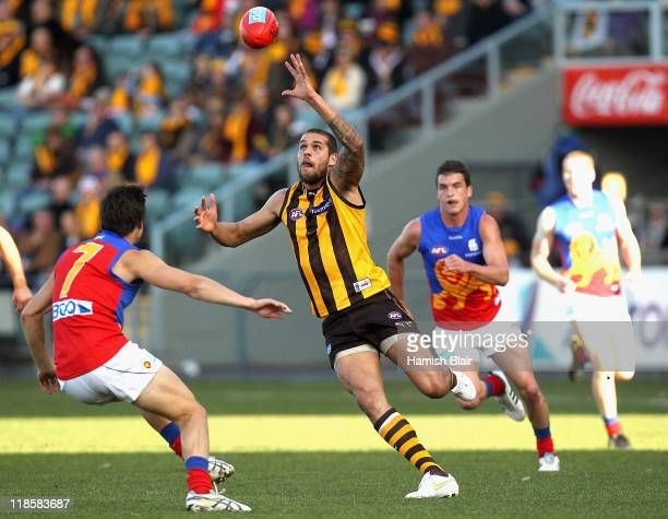 Lance Franklin of the Hawks runs off the wing to win a free kick and a 50m penalty to kick a goal during the round 16 AFL match between the Hawthorn...