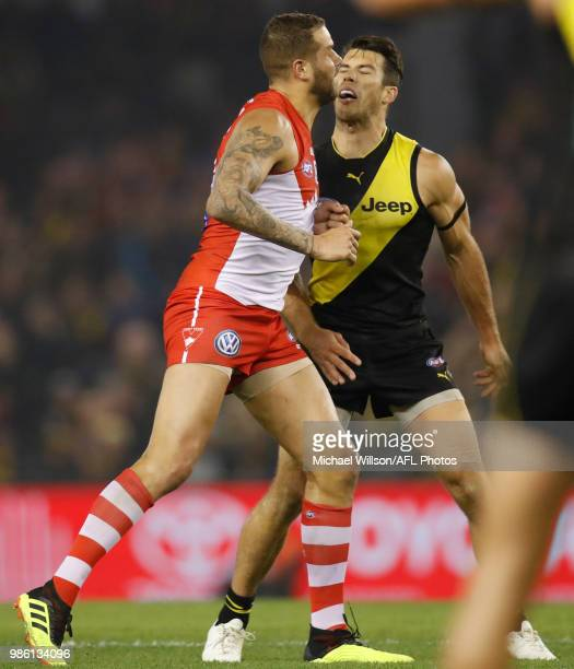 Lance Franklin of the Swans and Alex Rance of the Tigers clash during the 2018 AFL round15 match between the Richmond Tigers and the Sydney Swans at...
