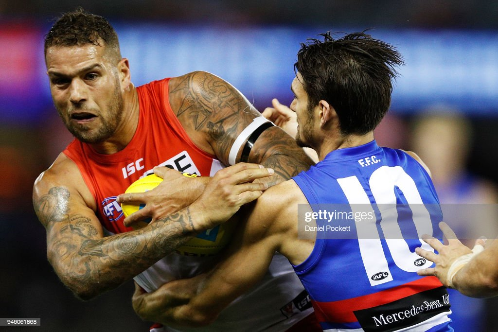 Lance Franklin of the Swans and Easton Wood of the Bulldogs contest the ball during the round four AFL match between the Western Bulldogs and the Sydney Swans at Etihad Stadium on April 14, 2018 in Melbourne, Australia.