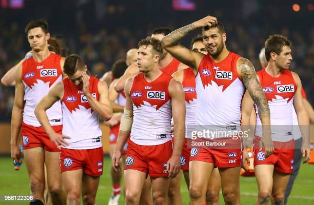 Lance Franklin of the Swans and his teammates leave the field after losing the round 15 AFL match between the Richmond Tigers and the Sydney Swans at...