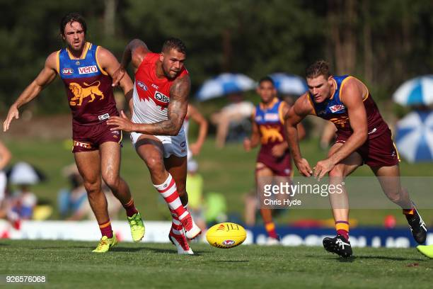 Lance Franklin of the Swans and Jack Payne of the Lions compete for the ball during the AFL JLT Community Series match between the Brisbane Lions and...