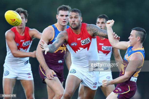 Lance Franklin of the Swans and Lewis Taylor of the Lions compete for the ball during the AFL JLT Community Series match between the Brisbane Lions...