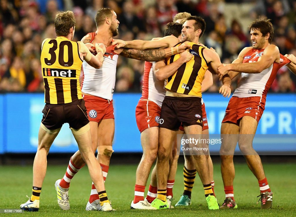 Lance Franklin of the Swans and Luke Hodge of the Hawks push and shove during the round 19 AFL match between the Hawthorn Hawks and the Sydney Swans at Melbourne Cricket Ground on July 28, 2017 in Melbourne, Australia.