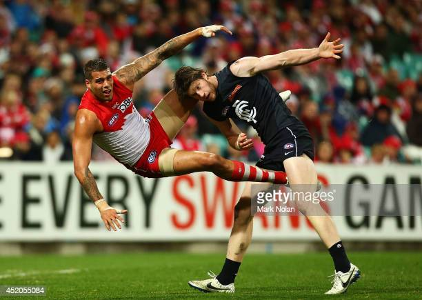 Lance Franklin of the Swans and Sam Rowe of the Blues get tangled during the round 17 AFL match between the Sydney Swans and the Carlton Blues at...
