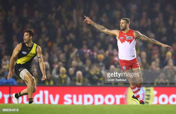 Lance Franklin of the Swans appeals after having his kick charged down by Alex Rance of the Tigers and is awarded 50 meters and kicks a goal at the...