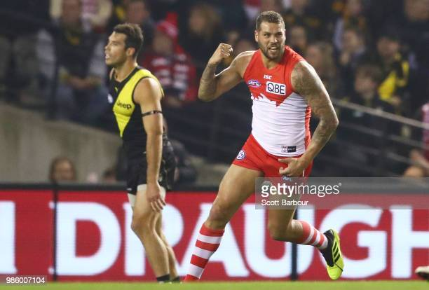 Lance Franklin of the Swans celebrates after kicking a goal as Alex Rance of the Tigers looks on during the round 15 AFL match between the Richmond...