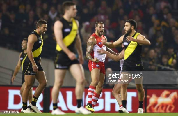 Lance Franklin of the Swans celebrates after kicking a goal as the Tigers look on during the round 15 AFL match between the Richmond Tigers and the...