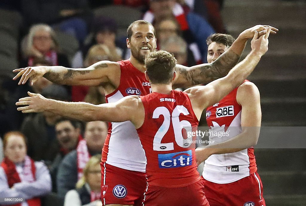 Lance Franklin of the Swans celebrates after kicking a goal with Luke Parker of the Swans during the round 21 AFL match between the St Kilda Saints and the Sydney Swans at Etihad Stadium on August 13, 2016 in Melbourne, Australia.