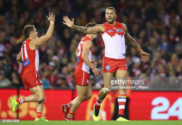 Lance Franklin of the Swans celebrates after kicking a goal with Tom Papley of the Swans during the round 12 AFL match between the St Kilda Saints...